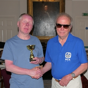 2019 British Braille Chess Champion, Paul Benson, receives trophy from Chairman, Norman Wragg